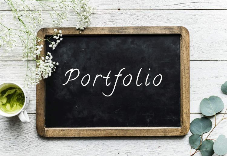 "A chalkboard with ""portfolio"" written on it. Photo by rawpixel.com on Unsplash."